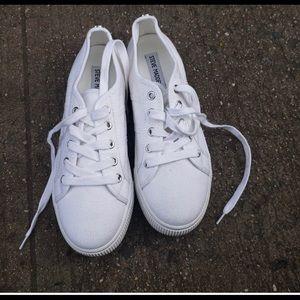 Steve Madden white platform sneakers.